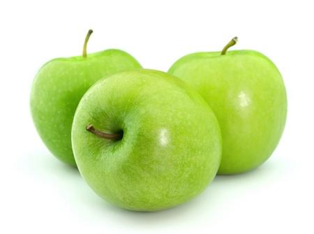 Mele verdi su sfondo bianco  Archivio Fotografico
