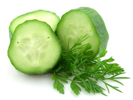 Lobes of a cucumber with parsley and to fennel on a white background photo