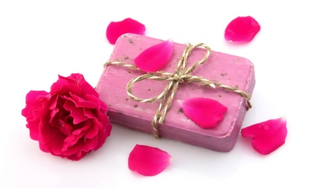Pink soap with rose on white  photo