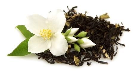 tea garden: jasmine tea with fresh jasmine flowers Stock Photo