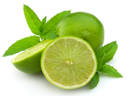 lime fruit: Lobes of a lime with a mint branch on a white background