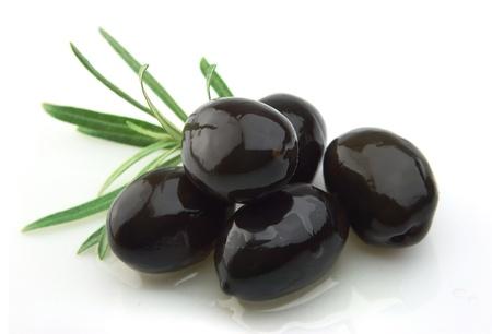 aceite de oliva: rama de olivo con aceite de oliva de cerca Foto de archivo