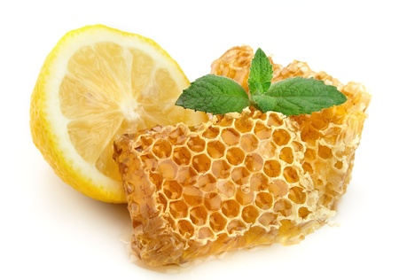 honey cell: Honey honeycombs with lemon and mint Stock Photo
