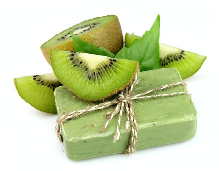 soap sud: Soap with fresh kiwi on the white