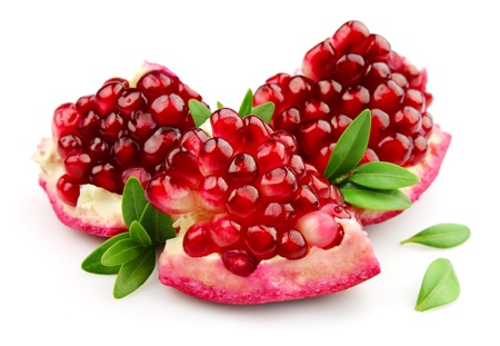 pomegranate juice: Sweet pomegranate with leafs close up Stock Photo