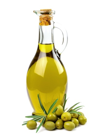 Branch with olives and a bottle of olive oil photo