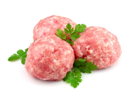 Fresh house forcemeat with greens on a white background photo