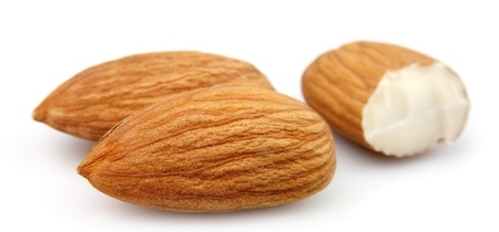 Dried almonds on white close up Stock Photo