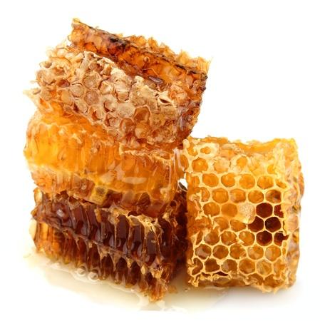 Honey honeycombs on a white background  Stock Photo