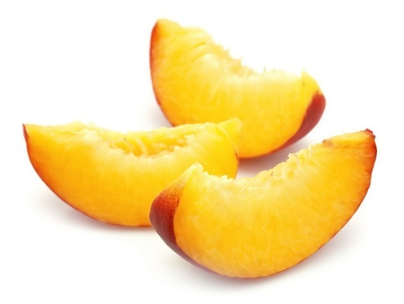 the peach: Juicy peach slices closeup