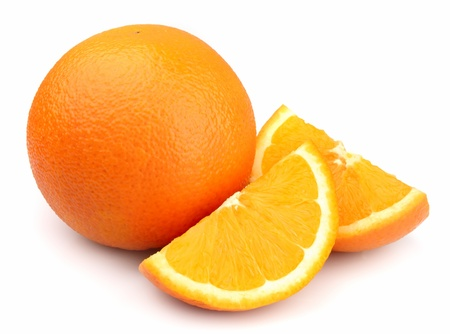 Fresh whole and sliced orange fruit on white