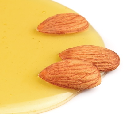 honey cake: Almonds nuts with honey on white. Component in cookery