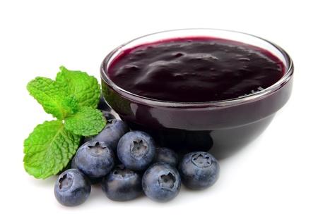 blueberry jam: Jam jar with blueberry and mint on white background  Stock Photo