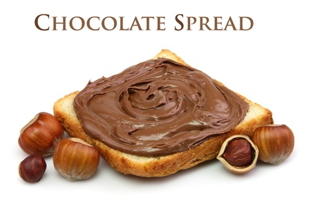 filbert nut: Bread with chocolate spread and filbert nuts close up Stock Photo