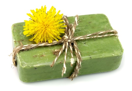 sudsy: Natural soap with dandelions on a white background  Stock Photo
