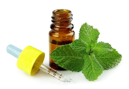 peppermint: bottle of peppermint oil and fresh min
