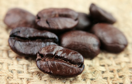 coffee beans closeup on linen texture Stock Photo - 12879874