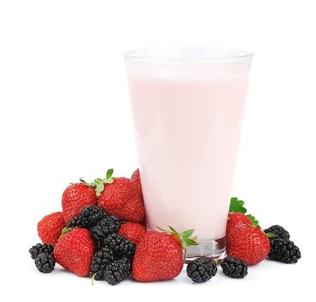 Fresh fruits and smoothies on white photo