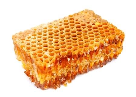raw gold: Honeycomb on white close up  Stock Photo