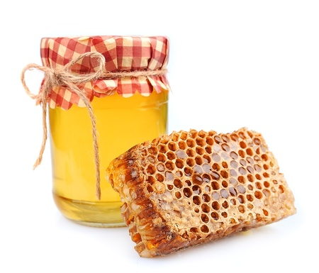 Jar of honey and honey honeycombs on a white background Stock Photo - 14048774