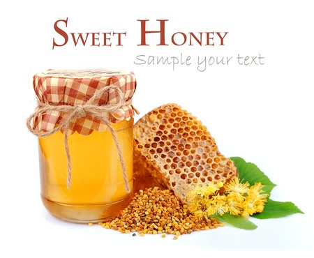blossom honey: Linden honey and honeycomb with linden flowers   Stock Photo
