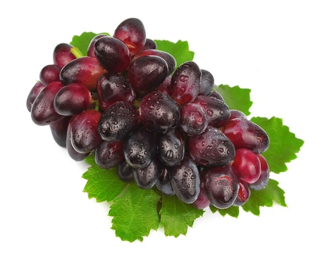 Sweet grapes fruit with drops water on white Stock Photo