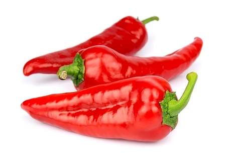 red  green: Red peppers on a white background