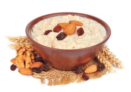 porridge: porridge with nuts of almonds, a walnut and raisin