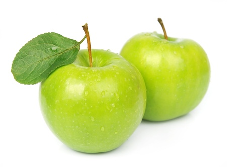 Two ripe green apples with leaves on white Stock Photo - 15466757