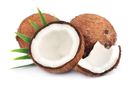 copra: Coconuts with leaves on a white background  Stock Photo