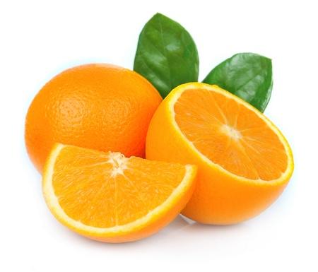 Sweet orange fruit with leaves on white