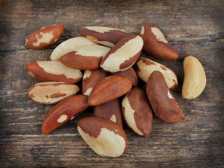 selenium: Bertholletia Brazil nuts on wooden texture