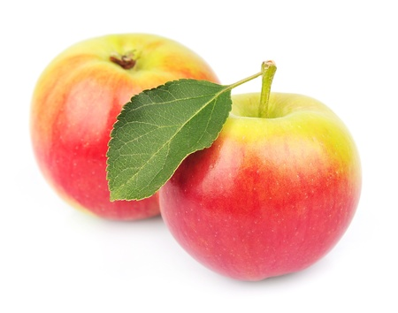 Two ripe summer apples with leaves on white Stock Photo - 16134763