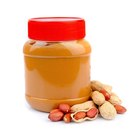 peanut butter: Peanut butter with nuts on white