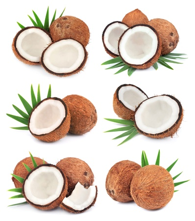 Collection of coconuts fruit with leafs on white close up Stock Photo - 17102727