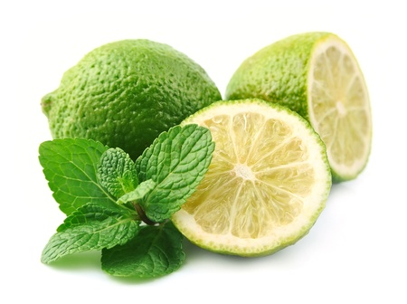 lobes: Lobes of a lime with a mint branch on a white background