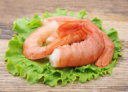 jumbo: shrimps with salad lettuce on wooden  background