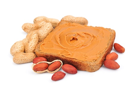 peanut butter and nuts  isolated on white photo