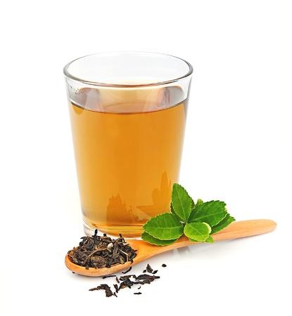 お茶と白地に茶葉 写真素材