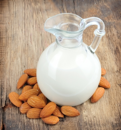 almond: Almond milk with almond on a wooden table
