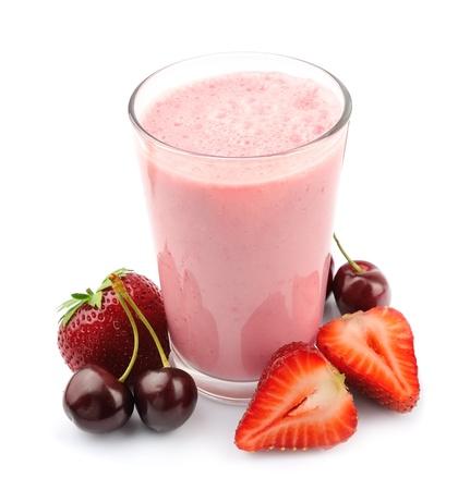 Vers fruit en smoothies op wit Stockfoto