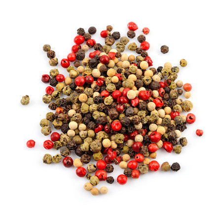 black pepper: Mix of dried peppers isolated on white. Pepper spice