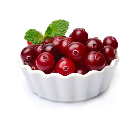 Sweet cranberries close up on white plate