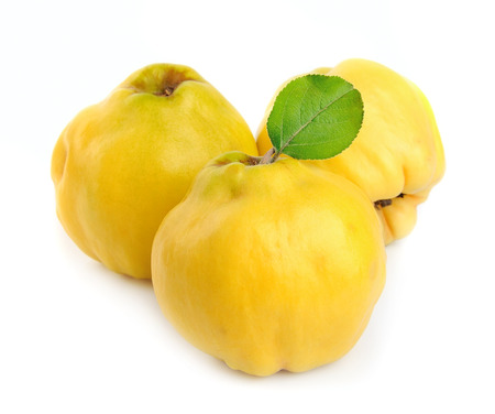 pectin: Ripe quince with leaves on a white background