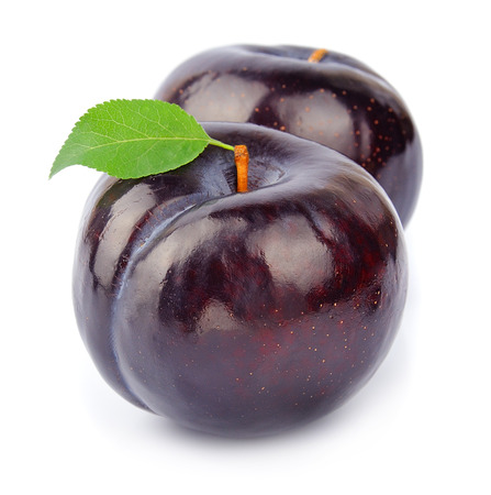 Sweet plums fruit on white closeup