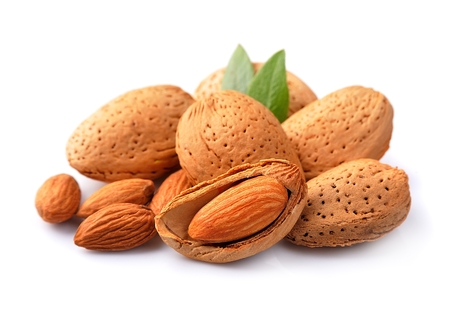 almond: Almonds nuts with leaves close up on white background .