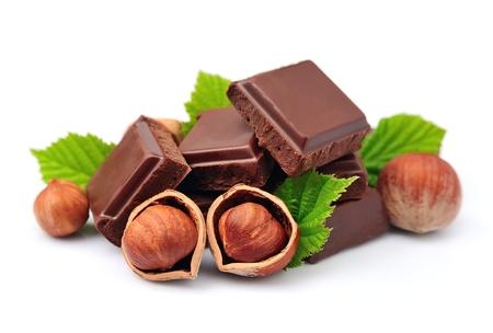 Chocolate with hazelnuts closeup Standard-Bild