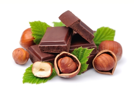 nuts: Chocolate with hazelnuts closeup Stock Photo