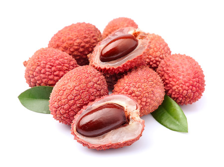 lichi: Sweet lychees fruits with leaves close up on white background .