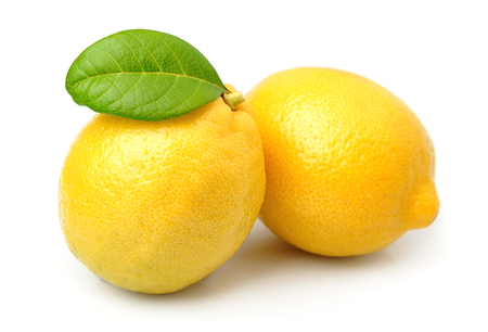 Lemon fruits with leaves on white